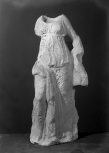 Small statue: a nymph or related figure, probably from a garden fountain