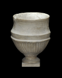 Round cinerary urn wtih large inset name plate.
