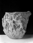 Fragment of a Roman marble vase carved with figures and foliage
