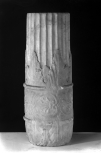 Section of a Roman decorative shaft or candelabrum stand with a fluted column-shaft rising from a double date palm-leaf sheathing, with stylised palmette enrichment between two high relief roll fillets.