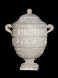 Roman funerary (cinerary) vase with a carved frieze of cupids riding sea beasts