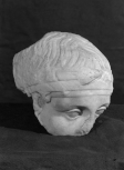 A head, a fragment of a classicizing relief