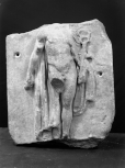 Fragmentary section of a relief panel(?): facing figure of Hermes