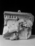Fragment of the right-hand end of the front of a child's sarcophagus depicting a chariot race of cupids in the circus