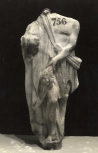 Headless male draped figure