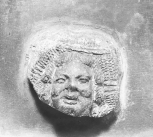 Fragment of ornament from a bowl(?): an eros-type mask