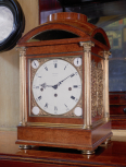 Eight-day quarter-chiming table clock, London, <i>c.</i>1835, for an existing case <i>c</i>.1812-35, probably designed by Soane, the dial and movement by Benjamin Vulliamy, (1780-1854), London, No. 1245, walnut, gilt bronze, brass, enamel, steel, silk and glass