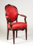 Oval-backed armchair, English, unknown maker, <i>c</i>.1829, mahogany upholstered in crimson silk damask,<sup>1</sup> decorative brass close nails around the upholstered seats and around the bases of the back uprights.
