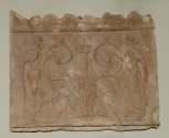 Roman roof Cresting Plaque depicting two women walking towards a stylised acanthus plant
