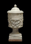 Cinerary vase decorated with candelabra and garlands