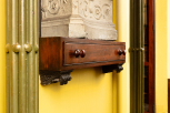 Built-in mahogany drawer serving as a pedestal for a work of art