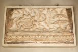 Fragmentary section of a small carved relief panel