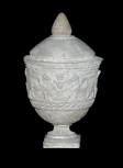 A Roman funerary (cinerary) vase decorated with pairs of griffins flanking symbolic ornaments resembling flaming candelabra