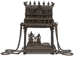 Model of a South Indian temple with a group of figures beneath the temple roof: Shiva, his consort Parvati and their son Skanda (or Kartikeya), bronze.