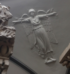 Nike or winged angel figure, in relief
