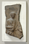 Fragment of a Roman cresting plaque depicting captive women in a mulecart in a triumphal procession
