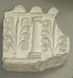 Fragment of an antique terracotta frieze with alternating columns and palmettes