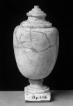 A solid marble Roman sculptured vase with lid and pedestal