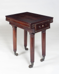 Table by John Robins (1776-1828), 1816, mahogany with brass mouldings, locks and castors