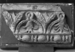 Fragment of Roman interior decoration: the top member of an architrave or door panel, consisting of fillet above<i> cyma reversa</i> enriched with alternate triple bay leaves and hollowed, reversed, waterleaf  with foliage inside, all highly stylised; and with a bead and reel moulding below.