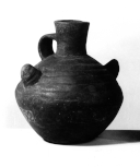 A Peruvian vessel, baked clay