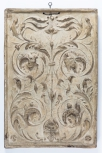 Cast of a panel with arabesque ornament and a mask, plaster, 16th C (also M1038, M1295)