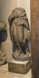 A cast of a headless draped female figure holding a book, perhaps a French late 16th century allegorical scupture