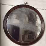 Convex mirror, English, unknown maker, early nineteenth century, mahogany frame with mirror glass, in a black reeded frame, with its original silvered glass and single brass hanging ring