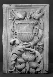 TOP SECTION OF A CARVED PILASTER