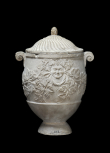 Cinerary vase carved with bacchanalian heads and vine leaves