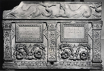 A Roman double funerary urn (cinerarium) carved with pilasters and foliage and with a separate lid.