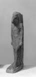 Statuette of the ibis-headed God Thoth, wearing a wig with lappets over the shoulders and a pleated loin cloth and standing with his left foot advanced, arms by his sides.