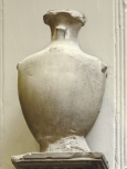 Cylindrical funerary (cinerary) urn with stylised lid and handles.