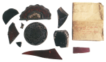 Fragments of ruby glass including badges of a Red (Lancaster) Rose and a fragment of a Tudor Rose